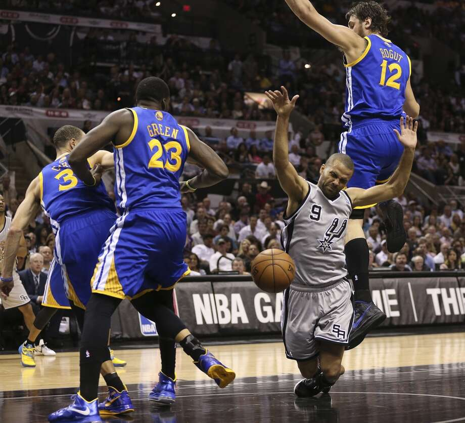 The Spurs' Tony Parker gets fouled as he drives between the Warriors' Jeremy Tyler (3), Draymond Green (23) and Andrew Bogut (12)  during the first half of Game 1 in the Western Conference semifinals at the AT&T Center, Monday, May 6, 2013.