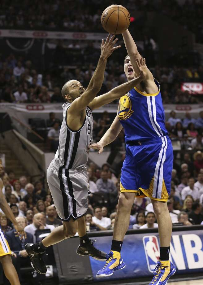 The Spurs' Tony Parker loses the ball under pressure from Warriors' Klay Thompson during the first half of Game 1 in the Western Conference semifinals at the AT&T Center, Monday, May 6, 2013.