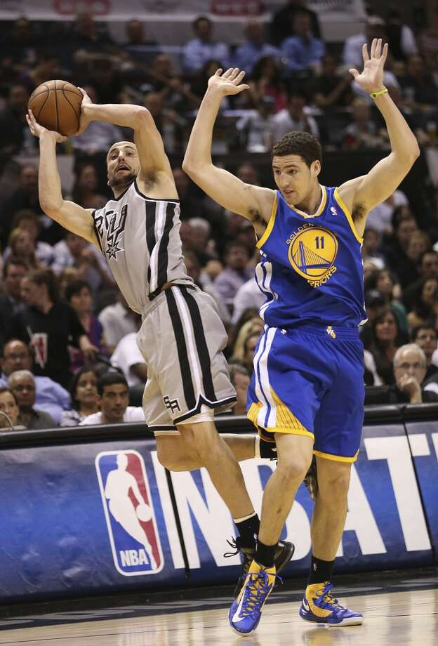The Spurs' Manu Ginobili is fouled by the Warriors' Klay Thompson during the first half of Game 1 in the Western Conference semifinals at the AT&T Center, Monday, May 6, 2013.