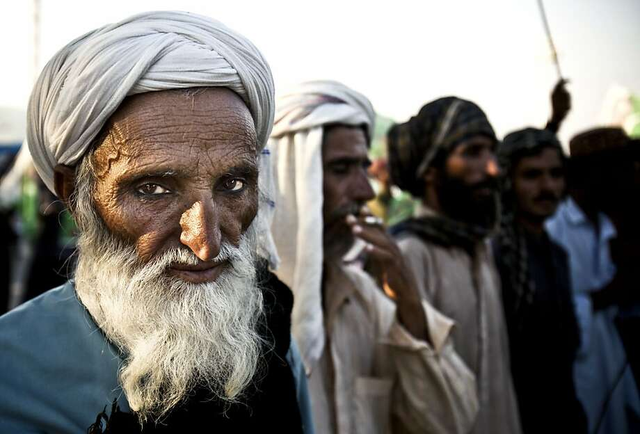Return our homes to us: In Islamabad, Baluch Bugti tribal men who were evicted from their villages after their leader was killed by the 