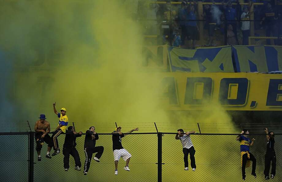 TOPSHOTS Supporters of Boca Juniors cheer their team during their Argentine First Division football match against River Plate, at the Bombonera stadium in Buenos Aires, Argentina, on May 5, 2013.  AFP PHOTO / Alejandro PAGNIALEJANDRO PAGNI/AFP/Getty Images Photo: Alejandro Pagni, AFP/Getty Images