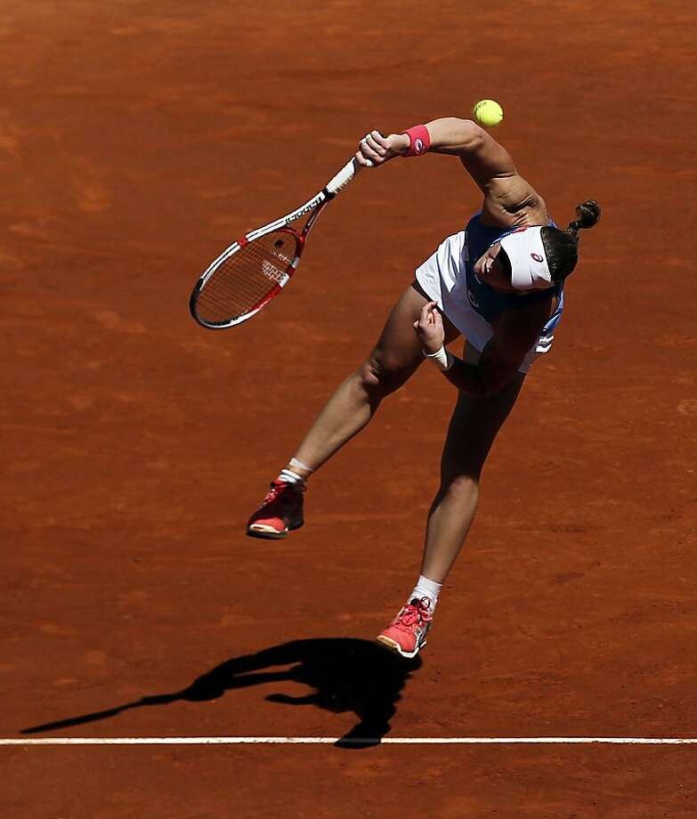 Samantha Stosur from Australia serves against Carla Suarez Navarro from Spain during the Madrid Open tennis tournament, in Madrid, Monday, May 6, 2013. (AP Photo/Andres Kudacki) Photo: Andres Kudacki, Associated Press