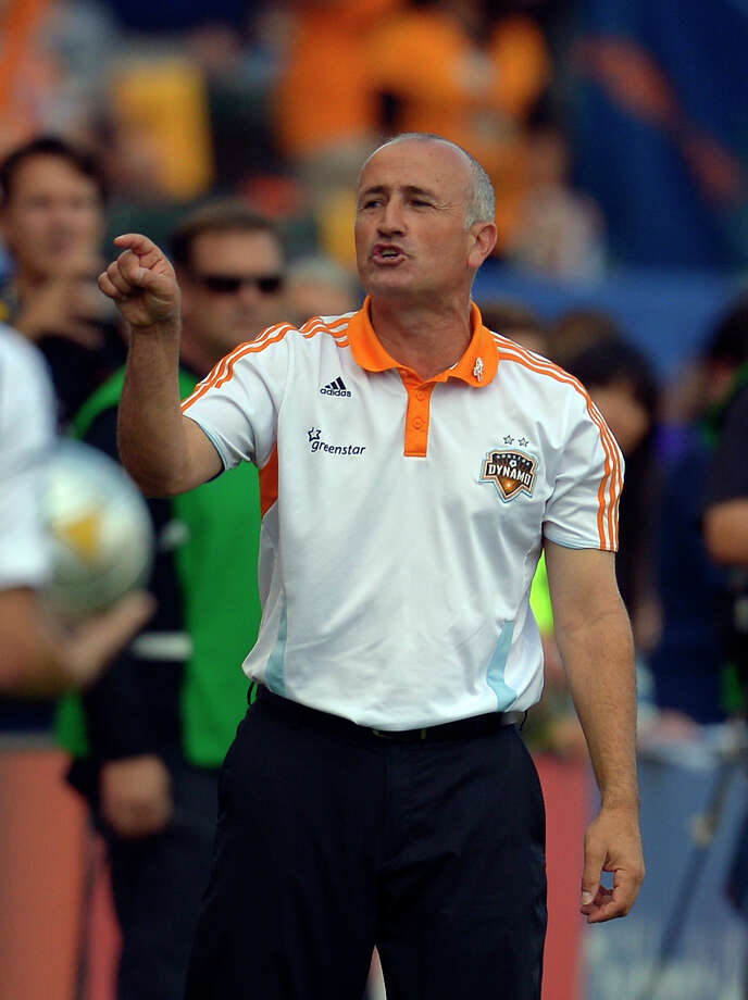 Dynamo coach Dominic Kinnear pointed to keeper Tally Hall's save on Landon Donovan's penalty kick as the turning point in the team's 1-0 win Sunday night. Photo: Mark J. Terrill, STF / AP