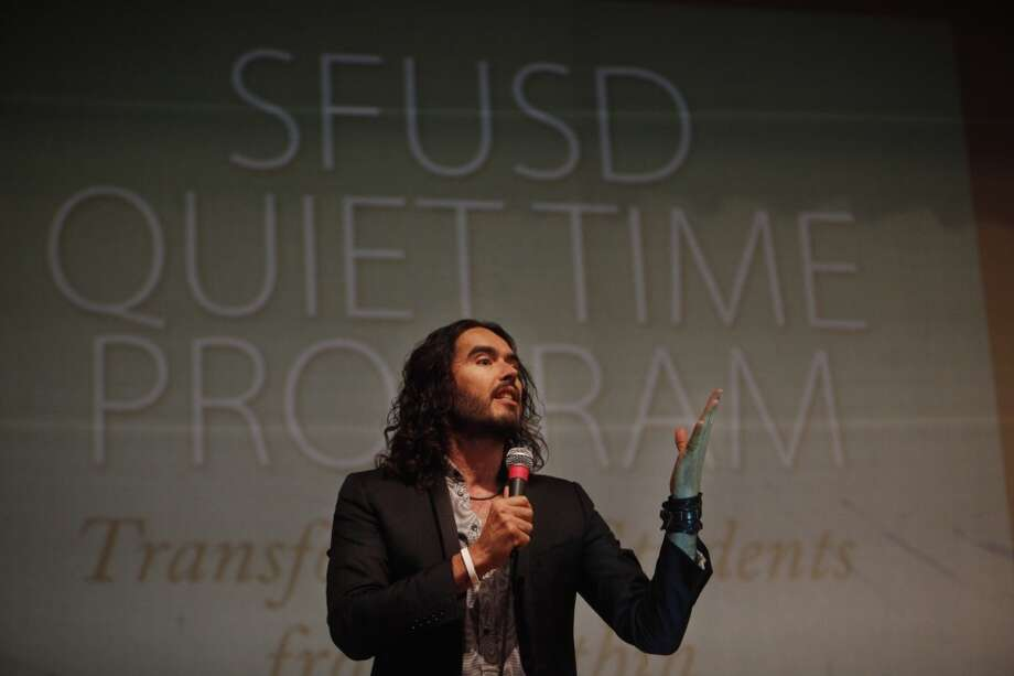 Actor Russell Brand speaks during the 6th anniversary celebration of the San Francisco Unified School District Quiet Time program at Phillip and Sala Burton Academic High School in San Francisco, Calif., on Monday May 6, 2013.