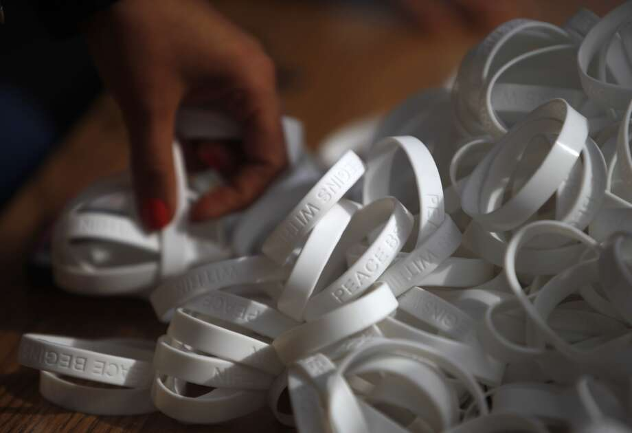 "White bracelets that say ""Peace Begins Within"" are handed out before the 6th anniversary celebration of the San Francisco Unified School District Quiet Time program at Phillip and Sala Burton Academic High School in San Francisco, Calif., on Monday May 6, 2013."