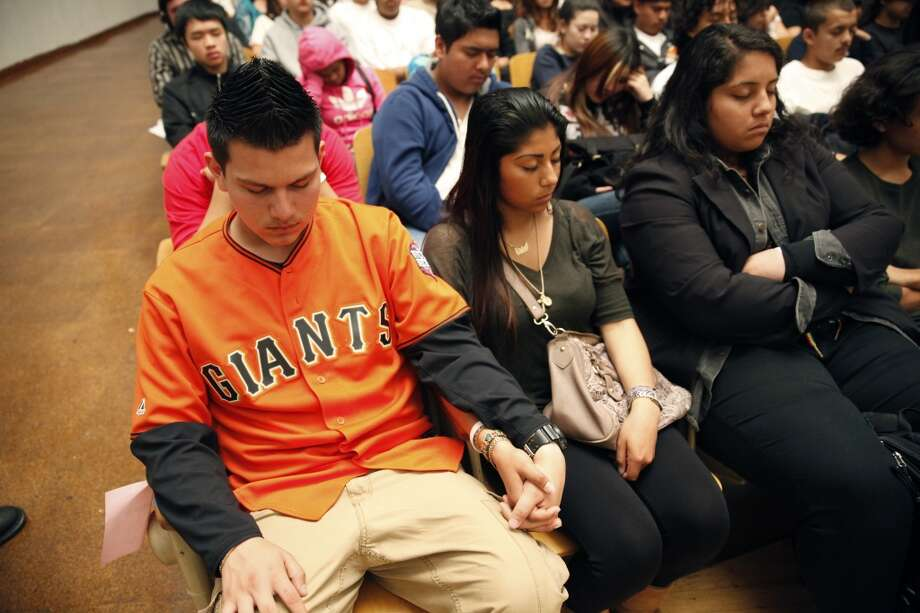 Jesse Martinez (l to r), 16, and Erin Chable, 17, both of John O'Connell High School hold hands as they participate in quiet time with other students during the 6th anniversary celebration of the San Francisco Unified School District Quiet Time program at Phillip and Sala Burton Academic High School in San Francisco, Calif., on Monday May 6, 2013.