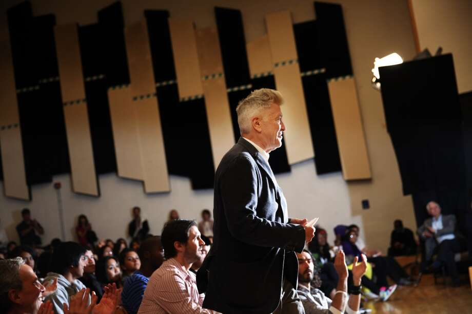 Director David Lynch stands to accept his certificate of recognition during the 6th anniversary celebration of the San Francisco Unified School District Quiet Time program at Phillip and Sala Burton Academic High School in San Francisco, Calif., on Monday May 6, 2013.