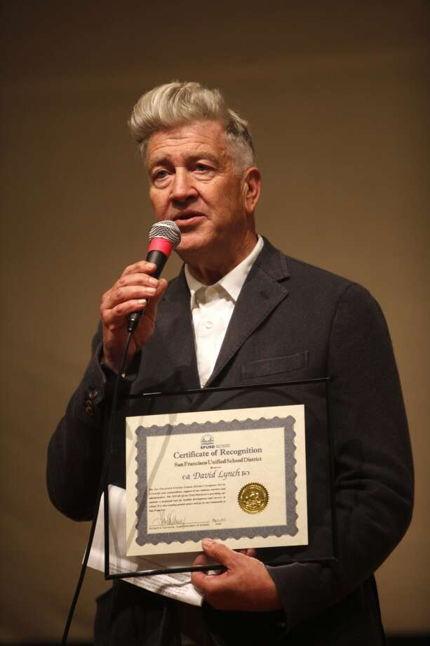 Director David Lynch stands with his certificate of recognition during the 6th anniversary celebration of the San Francisco Unified School District Quiet Time program at Phillip and Sala Burton Academic High School in San Francisco, Calif., on Monday May 6, 2013.