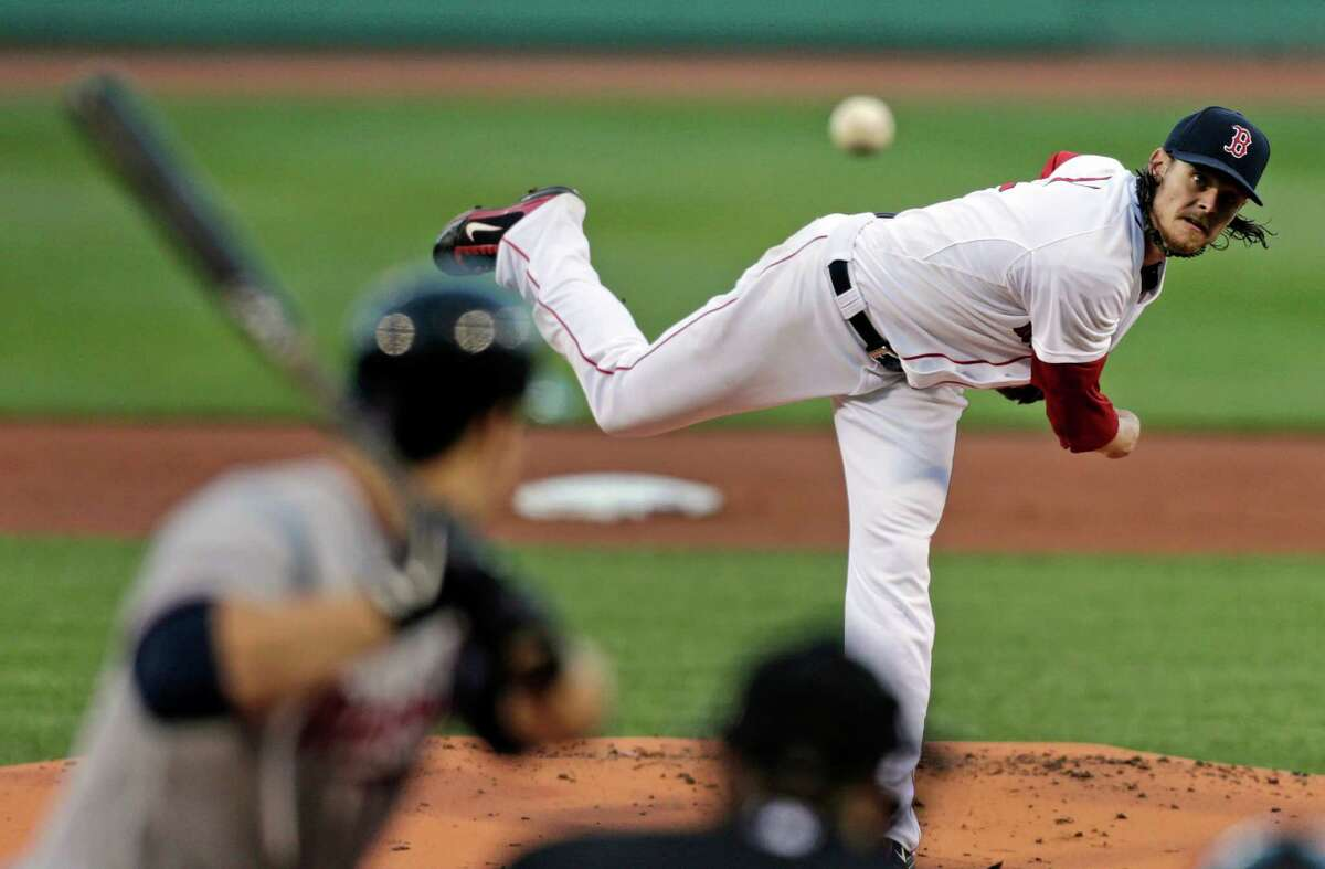 Boston Red Sox starting pitcher Clay Buchholz delivers during the first inning of a baseball game against the Minnesota Twins at Fenway Park in Boston, Monday, May 6, 2013. (AP Photo/Charles Krupa)