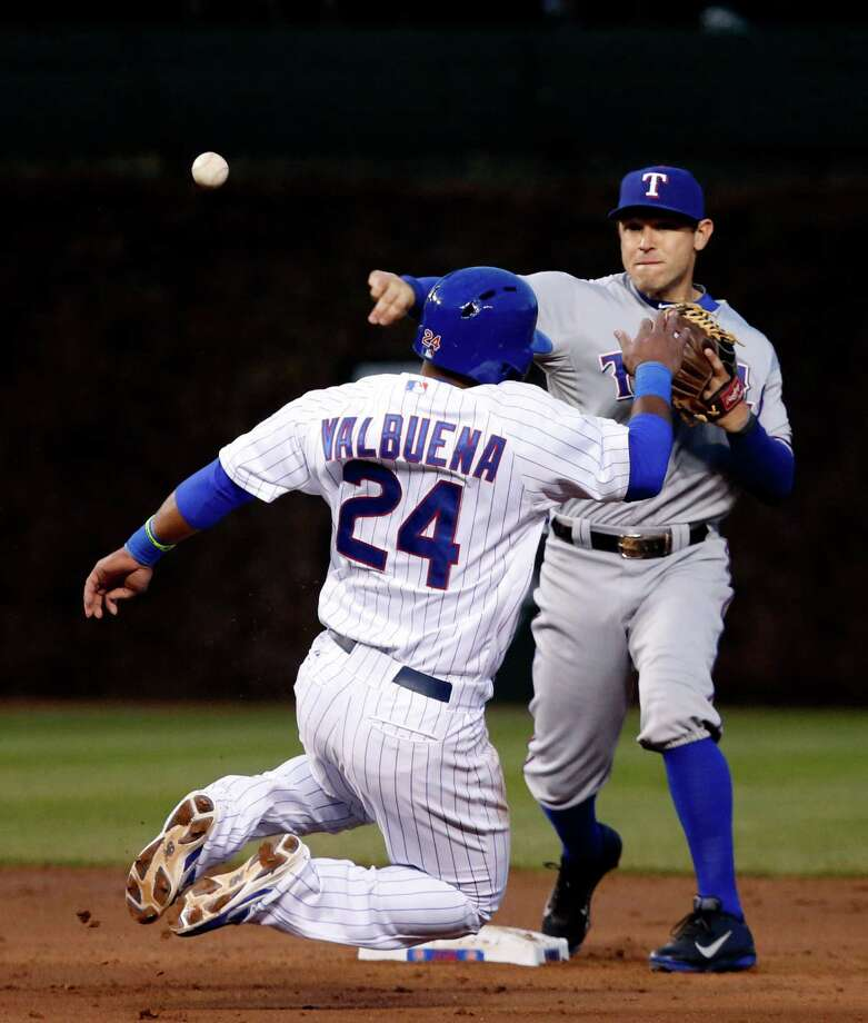 Texas Rangers second baseman Ian Kinsler, right, turns the double play as he forces Chicago Cubs' Luis Valbuena at second and gets the out on Darwin Barney at first during the second inning of a baseball game, Monday, May 6, 2013, in Chicago. (AP Photo/Charles Rex Arbogast) Photo: Charles Rex Arbogast