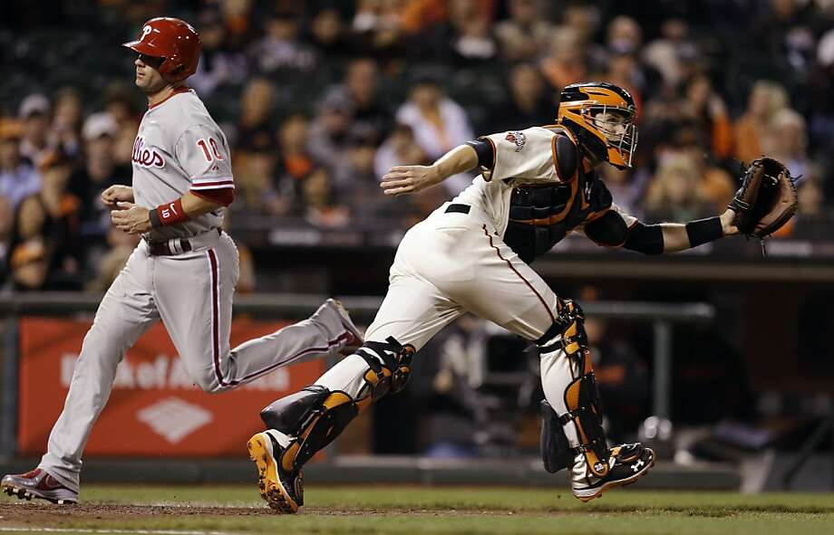 Philadelphia Phillies' Michael Young, left, scores past San Francisco Giants catcher Buster Posey in the fifth inning of a baseball game, Monday, May 6, 2013, in San Francisco. Young scored on a sacrifice fly hit by Delmon Young. (AP Photo/Ben Margot) Photo: Ben Margot, Associated Press
