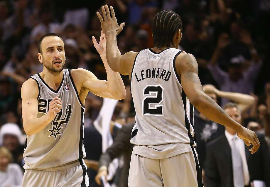 SAN ANTONIO, TX - MAY 06:  Manu Ginobili #20 of the San Antonio Spurs celebrates with Kawhi Leonard #2 after scoring the game winning shot against the Golden State Warriors in double overtime during Game One of the Western Conference Semifinals of the 2013 NBA Playoffs at AT&T Center on May 6, 2013 in San Antonio, Texas.  NOTE TO USER: User expressly acknowledges and agrees that, by downloading and or using this photograph, User is consenting to the terms and conditions of the Getty Images License Agreement.  (Photo by Ronald Martinez/Getty Images) Photo: Ronald Martinez, Getty Images