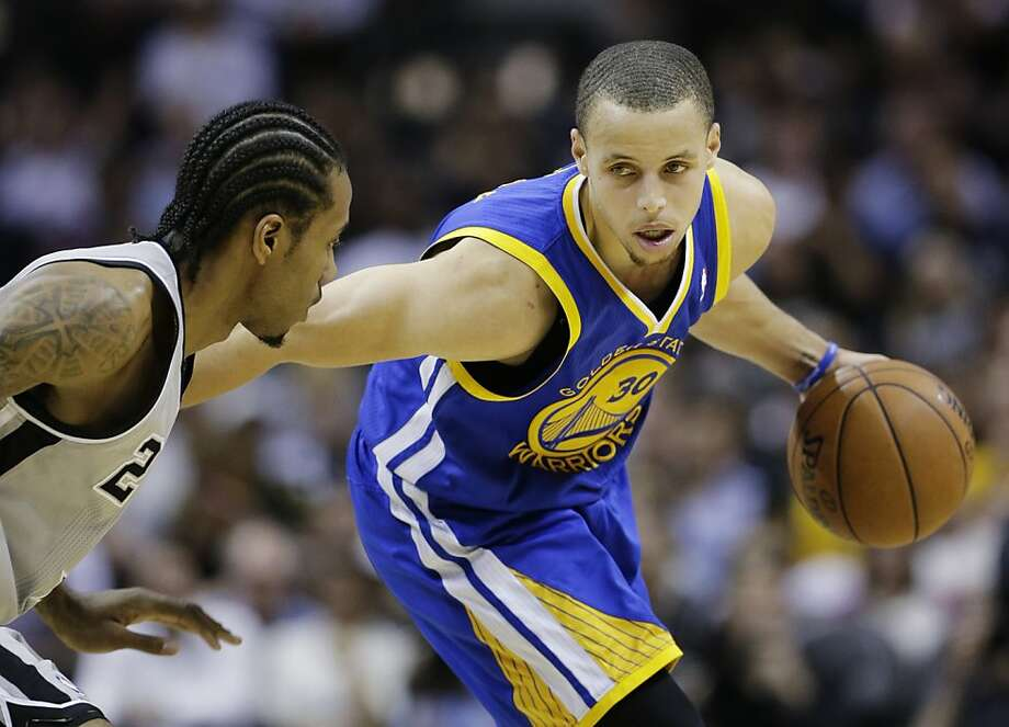 Golden State Warriors point guard Stephen Curry (30) is guarded by San Antonio Spurs small forward Kawhi Leonard (2)during the second half of Game 1 of a Western Conference semifinal NBA basketball playoff series, Monday, May 6, 2013, in San Antonio. (AP Photo/Eric Gay) Photo: Eric Gay, Associated Press