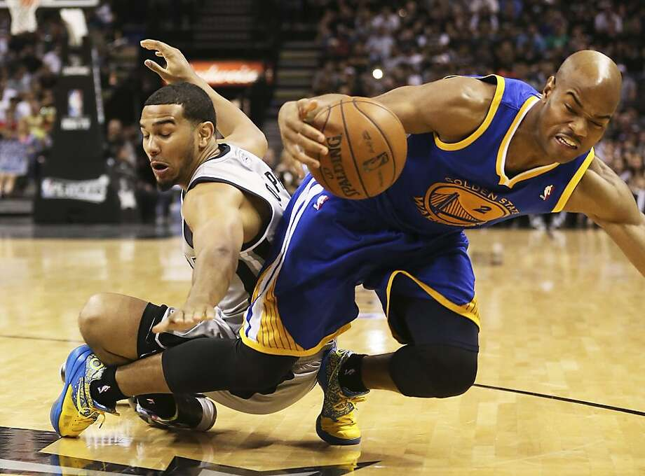 San Antonio Spurs' Cory Joseph scrambles for a loose ball  against Golden State Warriors' Jarrett Jack during the second half of Game 1 in the NBA Western Conference semifinals at the AT&T Center, Monday, May 6, 2013. The Spurs won in double overtime 129-127. Photo: Jerry Lara, San Antonio Express-News