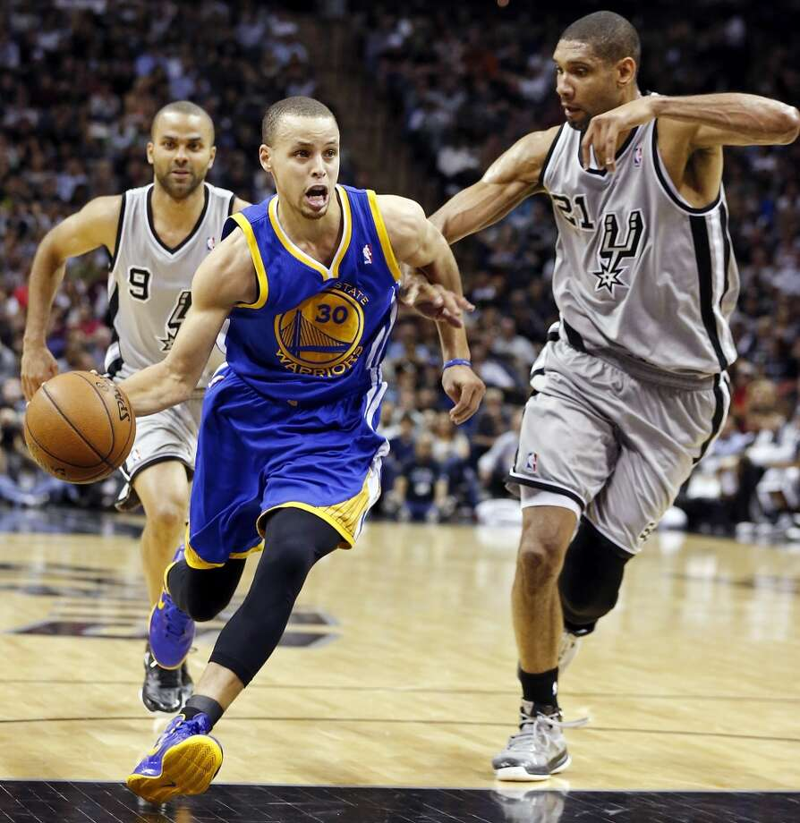 The Warriors' Stephen Curry looks for room  around the Spurs' Tim Duncan during first half action of Game 1 in the Western Conference semifinals Monday May 6, 2013 at the AT&T Center.