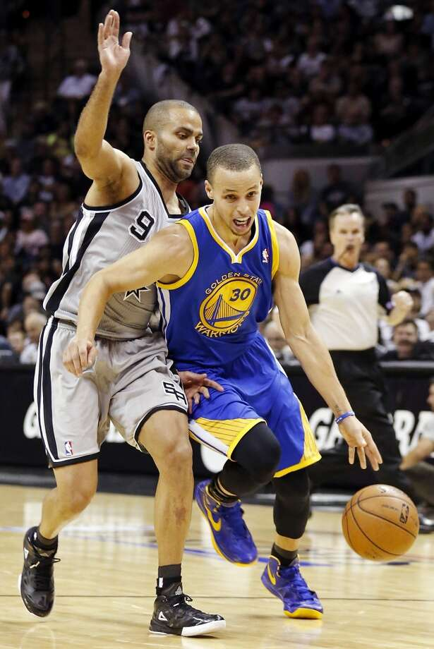 The Warriors' Stephen Curry drives around the Spurs' Tony Parker during first half action of Game 1 in the Western Conference semifinals Monday May 6, 2013 at the AT&T Center.