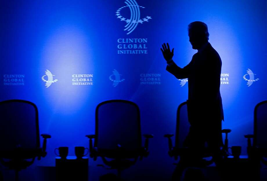 Former President Bill Clinton walks to the lectern at the Clinton Global Initiative (CGI) Mid-Year Meeting Monday, May 6, 2013 in New York. Details for CGI Latin America and a new commitment from the C40 Climate Leadership Group in partnership with the Clinton Foundation were announced at the event. (AP Photo/Craig Ruttle) Photo: Craig Ruttle, Associated Press