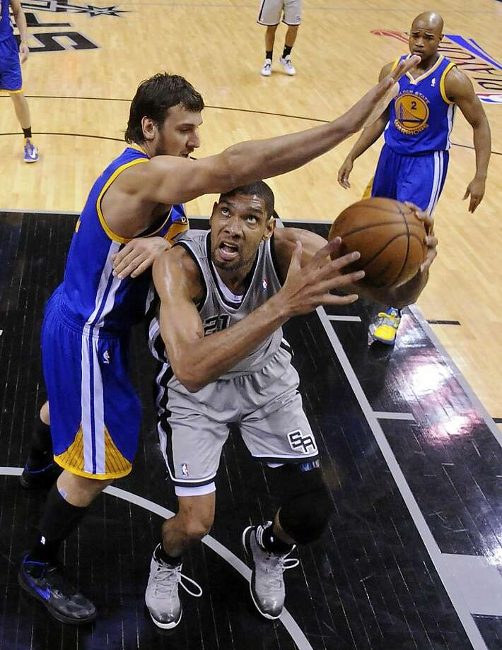 San Antonio Spurs' Tim Duncan looks for room under Golden State Warriors' Andrew Bogut in Game 1 of the NBA Western Conference semifinals Monday May 6, 2013 at the AT&T Center. The Spurs won 129-127 in double overtime. Photo: Edward A. Ornelas, San Antonio Express-News