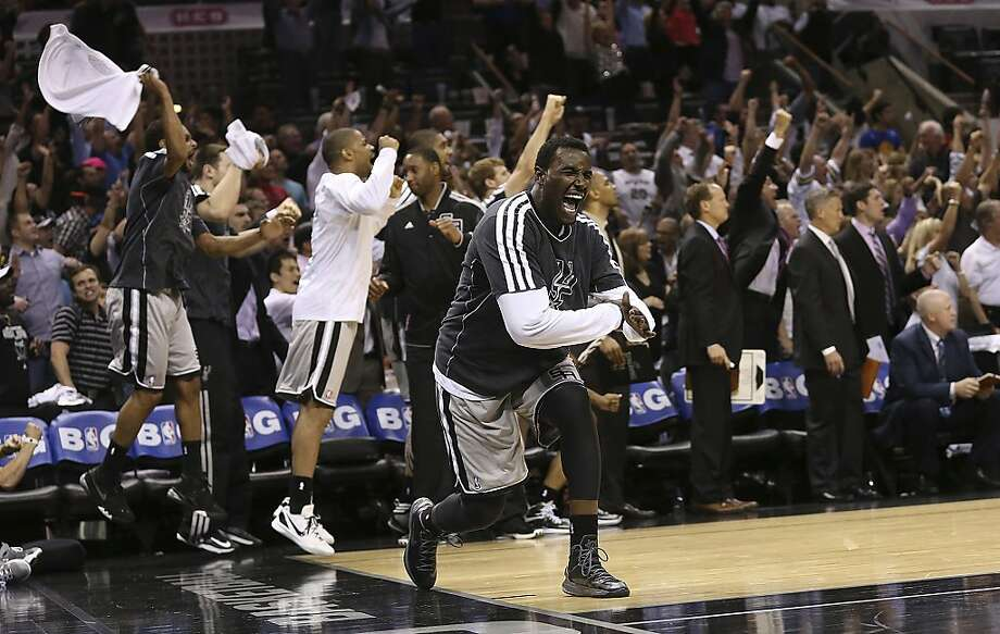 San Antonio Spurs' DeJuan Blair reacts along with the bench late in Game 1 of the NBA Western Conference semifinals against the Golden State Warriors at the AT&T Center, Monday, May 6, 2013. The Spurs won in double overtime 129-127. Photo: Jerry Lara, San Antonio Express-News