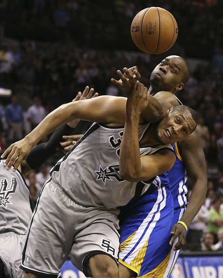 Golden State Warriors' Scott Machado fouls San Antonio Spurs' Boris Diaw late in Game 1 of the NBA Western Conference semifinals at the AT&T Center, Monday, May 6, 2013. The Spurs won in double overtime 129-127. Photo: Jerry Lara, San Antonio Express-News