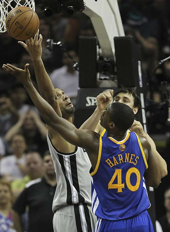 San Antonio Spurs' Tim Duncan goes for a rebound against Golden State Warriors' Harrison Barnes during the second half of Game 1 in the NBA Western Conference semifinals at the AT&T Center, Monday, May 6, 2013. The Spurs won in double overtime 129-127. Photo: Jerry Lara, San Antonio Express-News