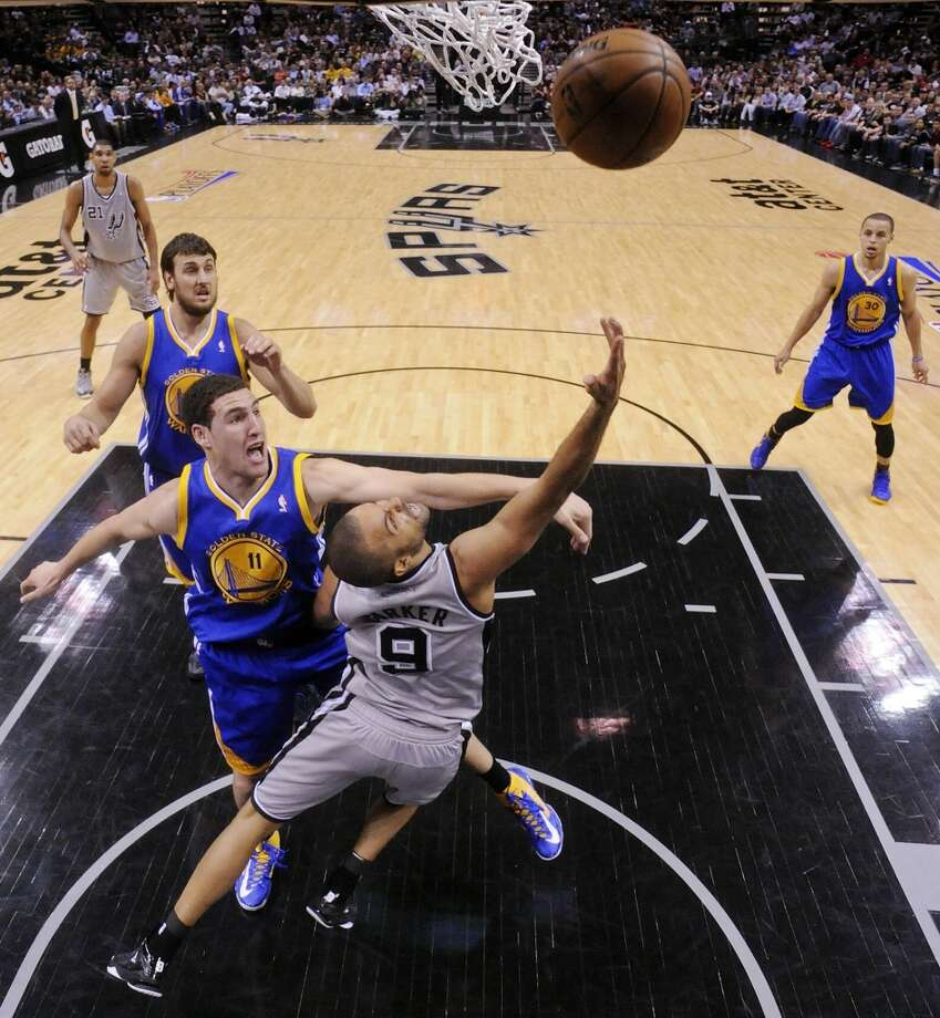 San Antonio Spurs' Tony Parker shoots around Golden State Warriors' Klay Thompson during first half action of Game 1 in the NBA Western Conference semifinals Monday May 6, 2013 at the AT&T Center. The Spurs won 129-127 in double overtime.