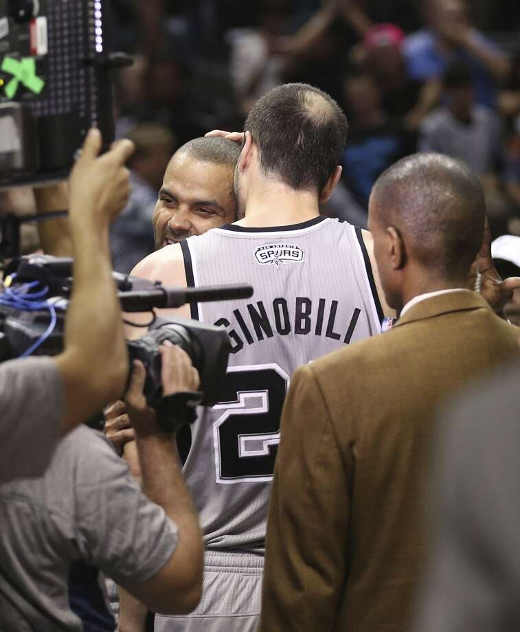 San Antonio Spurs' Tony Parker and Manu Ginobili hug after they pull off a double overtime victory against the Golden State Warriors in Game 1 of the NBA Western Conference semifinals at the AT&T Center, Monday, May 6, 2013. The Spurs won 129-127.
