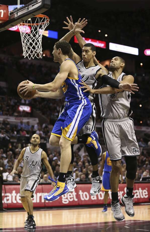San Antonio Spurs' Danny Green and Tim Duncan defend against Golden State Warriors' Klay Thompson during the second half of Game 1 in the NBA Western Conference semifinals at the AT&T Center, Monday, May 6, 2013. The Spurs won in double overtime 129-127.