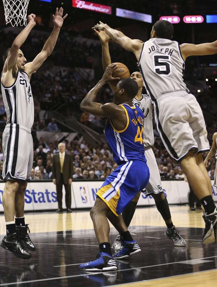 San Antonio Spurs' Manu Ginobili, Boris Diaw and Cory Joseph defend against Golden State Warriors' Harrison Barnes during the second half of Game 1 in the NBA Western Conference semifinals at the AT&T Center, Monday, May 6, 2013. The Spurs won in double overtime 129-127.