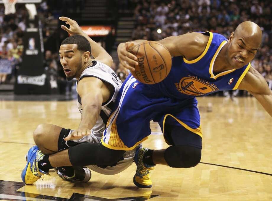 San Antonio Spurs' Cory Joseph scrambles for a loose ball  against Golden State Warriors' Jarrett Jack during the second half of Game 1 in the NBA Western Conference semifinals at the AT&T Center, Monday, May 6, 2013. The Spurs won in double overtime 129-127.