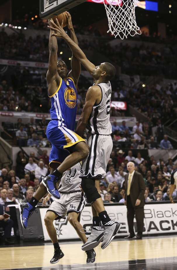 Golden State Warriors' Harrison Barnes scores over San Antonio Spurs' Tim Duncan during the second half in Game 1 of the NBA Western Conference semifinals at the AT&T Center, Monday, May 6, 2013. The Spurs won in double overtime 129-127.