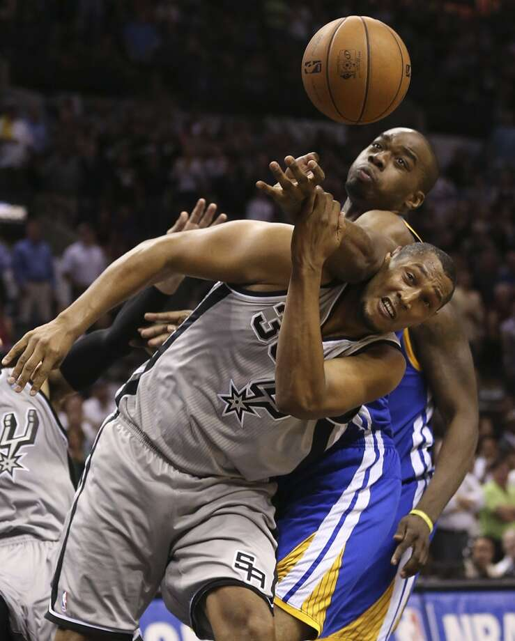 Golden State Warriors' Scott Machado fouls San Antonio Spurs' Boris Diaw late in Game 1 of the NBA Western Conference semifinals at the AT&T Center, Monday, May 6, 2013. The Spurs won in double overtime 129-127.