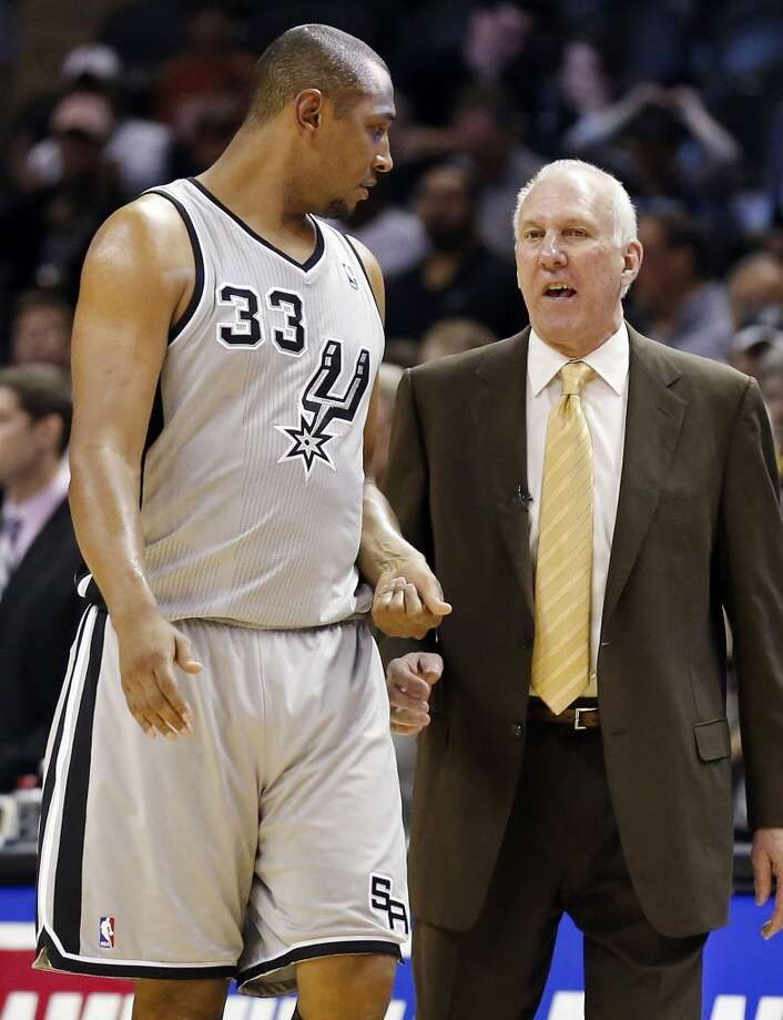 San Antonio Spurs' Boris Diaw talks with San Antonio Spurs head coach Gregg Popovich in double overtime action of Game 1 in the NBA Western Conference semifinals against the Golden State Warriors Monday May 6, 2013 at the AT&T Center. The Spurs won 129-127 in double overtime.