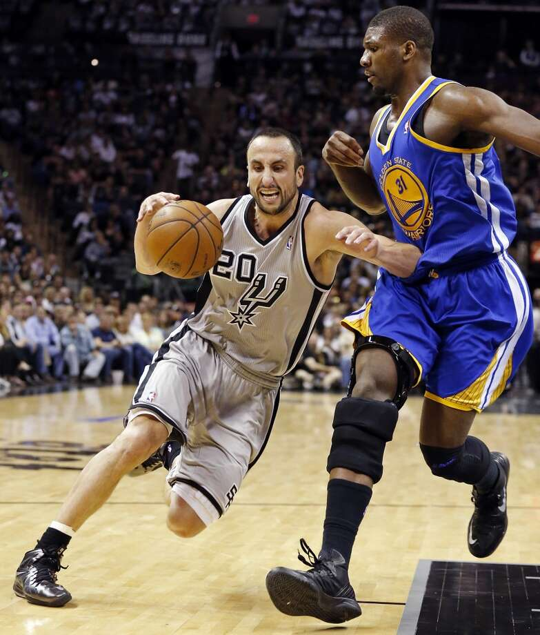 San Antonio Spurs' Manu Ginobili looks for room around Golden State Warriors' Festus Ezeli during second half action of Game 1 in the NBA Western Conference semifinals Monday May 6, 2013 at the AT&T Center. The Spurs won 129-127 in double overtime.