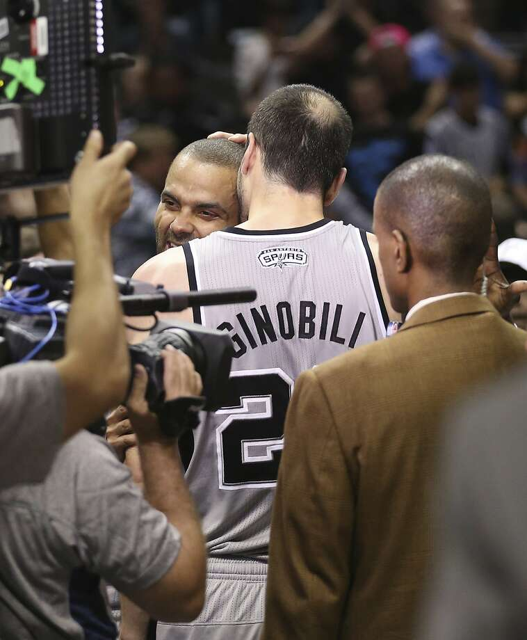 San Antonio Spurs' Tony Parker and Manu Ginobili hug after they pull off a double overtime victory against the Golden State Warriors in Game 1 of the NBA Western Conference semifinals at the AT&T Center, Monday, May 6, 2013. The Spurs won 129-127. Photo: Jerry Lara, San Antonio Express-News