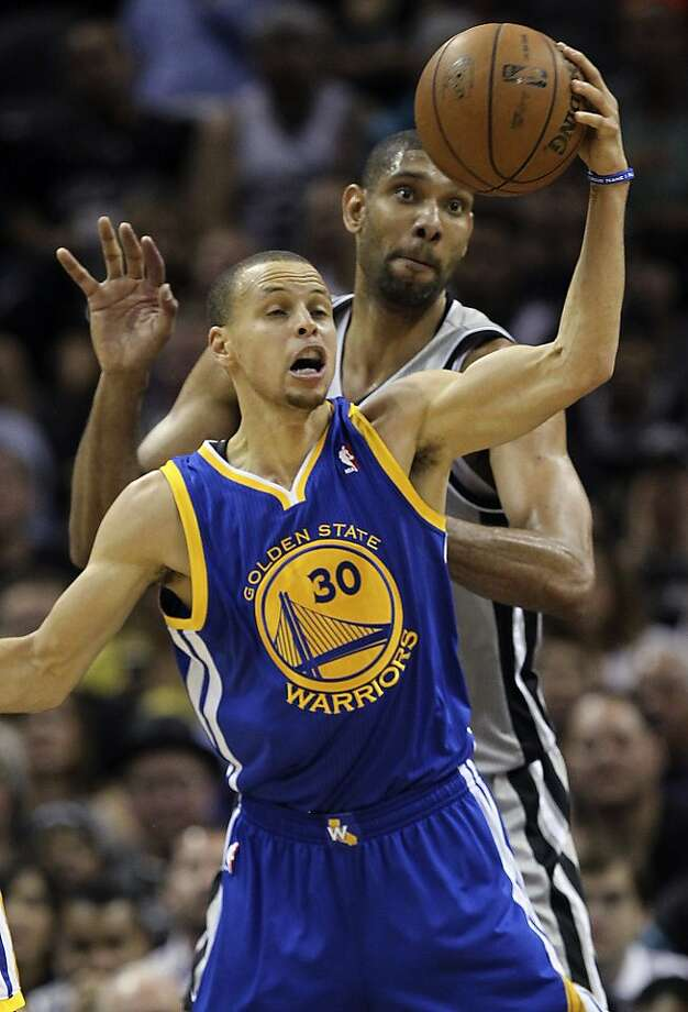 Golden State Warriors' Stephen Curry gets control of the ball as San Antonio Spurs' Tim Duncan defends during the first half of Game 1 in the NBA Western Conference semifinals at the AT&T Center, Monday, May 6, 2013. Photo: Jerry Lara, San Antonio Express-News