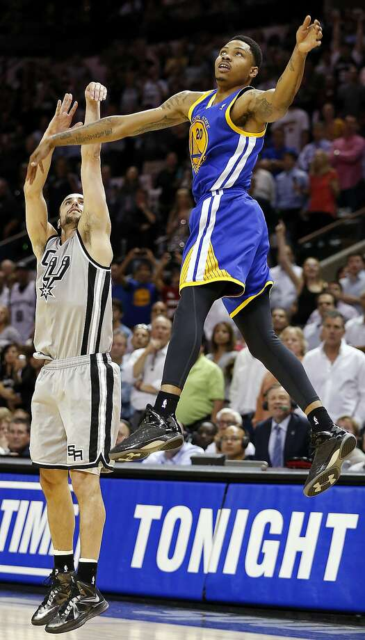 San Antonio Spurs' Manu Ginobili watches his game winning 3-pointer as he is defended by Golden State Warriors' Kent Bazemore late in double overtime of Game 1 in the NBA Western Conference semifinals against the Golden State Warriors Monday May 6, 2013 at the AT&T Center. The Spurs won 129-127 in double overtime. Photo: Edward A. Ornelas, San Antonio Express-News