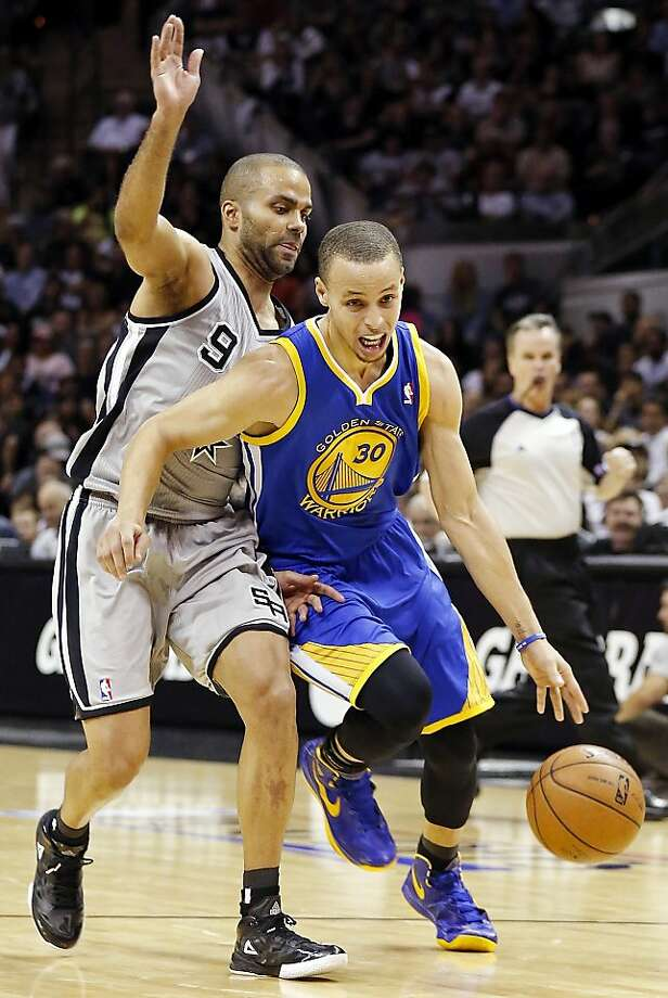 Golden State Warriors' Stephen Curry drives around San Antonio Spurs' Tony Parker during first half action of Game 1 in the NBA Western Conference semifinals Monday May 6, 2013 at the AT&T Center. Photo: Edward A. Ornelas, San Antonio Express-News