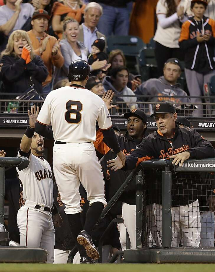 San Francisco Giants' Hunter Pence (8) is congratulated after hitting a home run off Philadelphia Phillies' Cliff Lee in the second inning of a baseball game, Monday, May 6, 2013, in San Francisco. (AP Photo/Ben Margot) Photo: Ben Margot, Associated Press