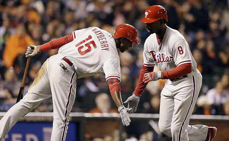 Philadelphia Phillies' Domonic Brown, right, is congratulated by John Mayberry Jr., after hitting a home run off San Francisco Giants' Madison Bumgarner in the fifth inning of a baseball game, Monday, May 6, 2013, in San Francisco. (AP Photo/Ben Margot) Photo: Ben Margot, Associated Press