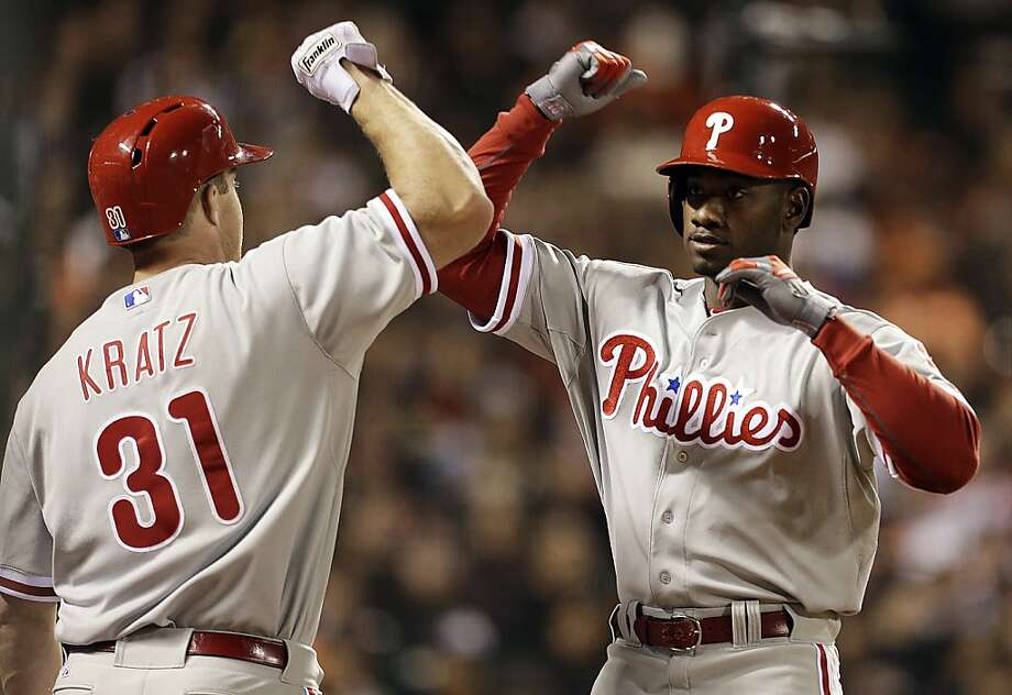 Philadelphia Phillies' Domonic Brown, right, is congratulated by Erik Kratz (31) after hitting a home run off San Francisco Giants' Madison Bumgarner in the fifth inning of a baseball game, Monday, May 6, 2013, in San Francisco. (AP Photo/Ben Margot) Photo: Ben Margot, Associated Press