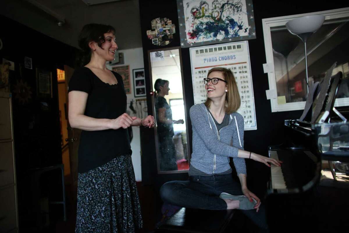 Voice teacher Lorrie Ruiz, left, works with student Heather Newton during a lesson at the Seattle Drum School in north Seattle on May 4, 2013.