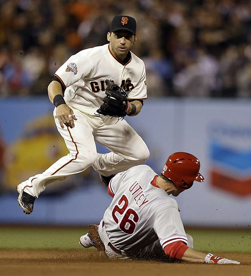 San Francisco Giants second baseman Marco Scutaro hops over Philadelphia Phillies' Chase Utley after completing a double play in the seventh inning of a baseball game Monday, May 6, 2013, in San Francisco. Phillies Michael Young was out at first base on the play. (AP Photo/Ben Margot) Photo: Ben Margot, Associated Press
