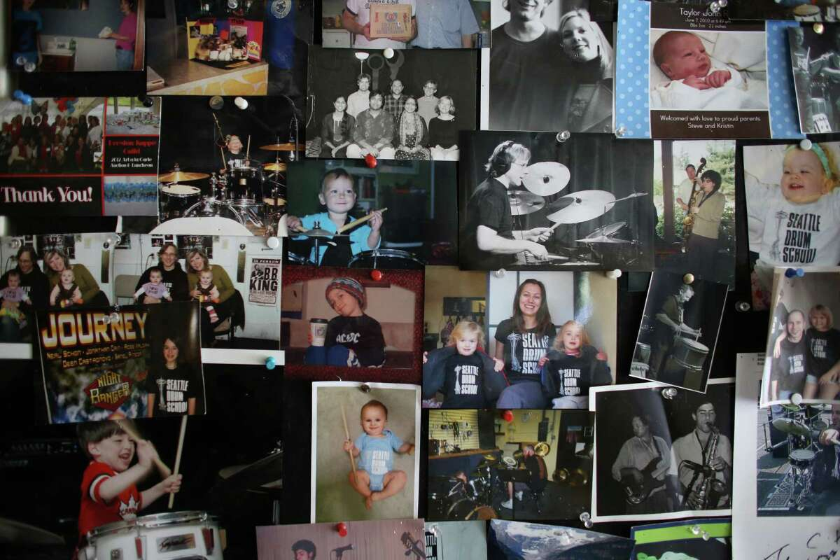 A wall of photos is shown at the Seattle Drum School in north Seattle on May 4, 2013.