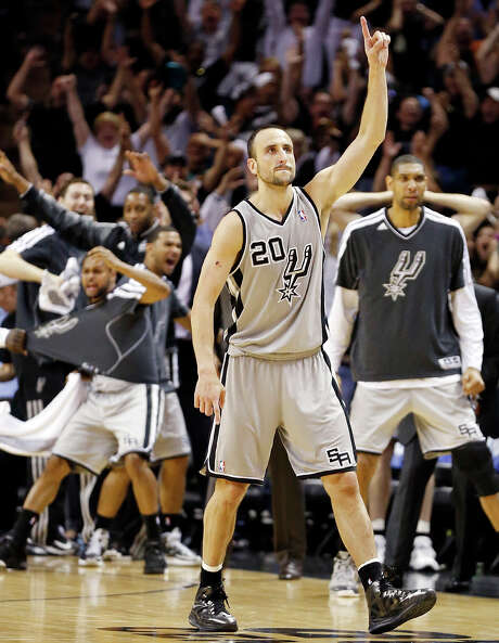 Spurs guard Manu Ginobili celebrates after making the game-winning 3-pointer in the second overtime against the Warriors on Monday night at the AT&T Center.  Edward A. Ornelas / San Antonio Express-News / © 2013 San Antonio Express-News