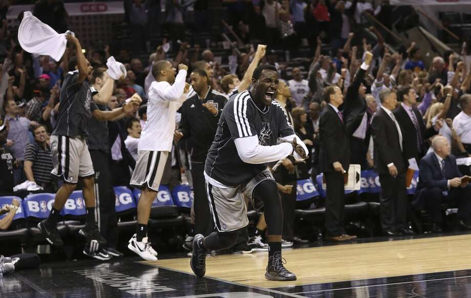 San Antonio Spurs' DeJuan Blair reacts along with the bench late in Game 1 of the NBA Western Conference semifinals against the Golden State Warriors at the AT&T Center, Monday, May 6, 2013. The Spurs won in double overtime 129-127.