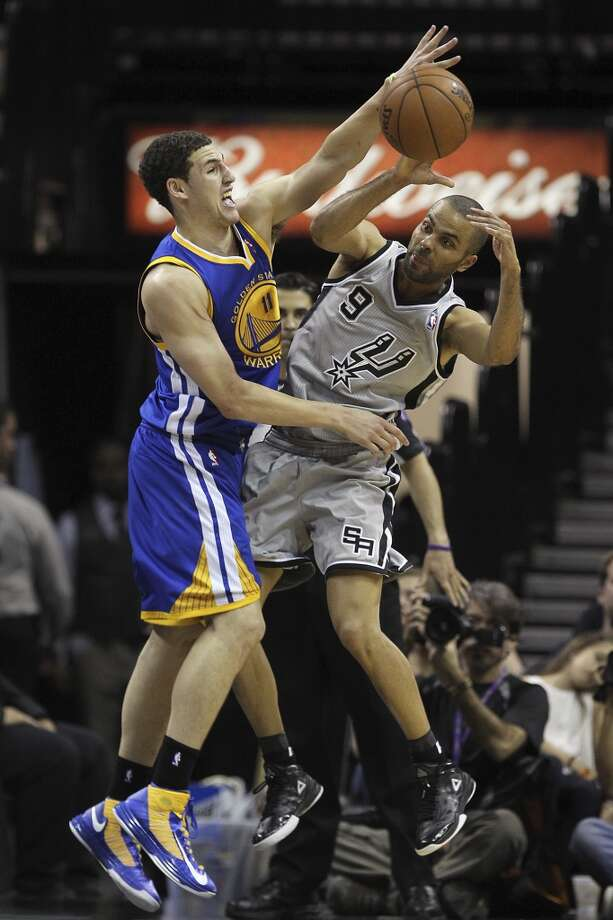 San Antonio Spurs' Tony Parker gets pressure from Golden State Warriors' Klay Thompson during the second half of Game 1 in the NBA Western Conference semifinals at the AT&T Center, Monday, May 6, 2013. The Spurs won in double overtime 129-127.