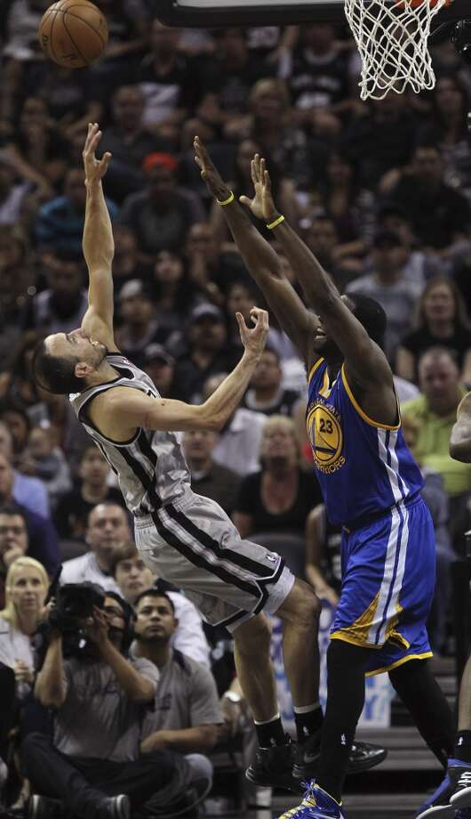 San Antonio Spurs' Manu Ginobili shoots over Golden State Warriors' Draymond Green during the second half of Game 1 in the NBA Western Conference semifinals at the AT&T Center, Monday, May 6, 2013. The Spurs won in double overtime 129-127.