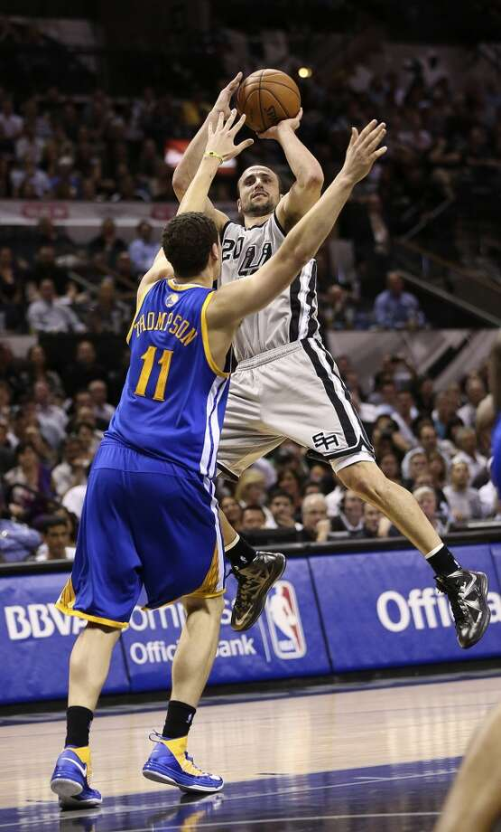 San Antonio Spurs' Manu Ginobili shoots over Golden State Warriors' Klay Thompson during the first half of Game 1 in the NBA Western Conference semifinals at the AT&T Center, Monday, May 6, 2013.