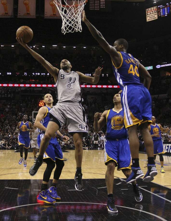 San Antonio Spurs' Tony Parker drives against Golden State Warriors' Harrison Barnes during Game 1 in the NBA Western Conference semifinals at the AT&T Center, Monday, May 6, 2013. The Spurs won in double overtime 129-127.
